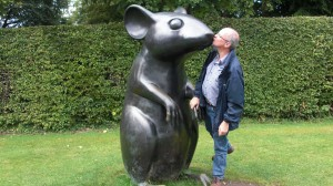 ok, ok kiss the statue for the camera, but do you have to hold its paw as well?