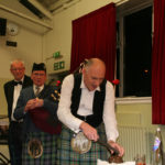 Alan Addresses the Haggis as Neil and Bob look on